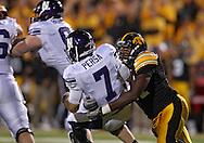 October 15, 2011: Iowa Hawkeyes defensive lineman Broderick Binns (91) sacks Northwestern Wildcats quarterback Dan Persa (7) and causes a fumble during the second half of the NCAA football game between the Northwestern Wildcats and the Iowa Hawkeyes at Kinnick Stadium in Iowa City, Iowa on Saturday, October 15, 2011. Iowa defeated Northwestern 41-31.