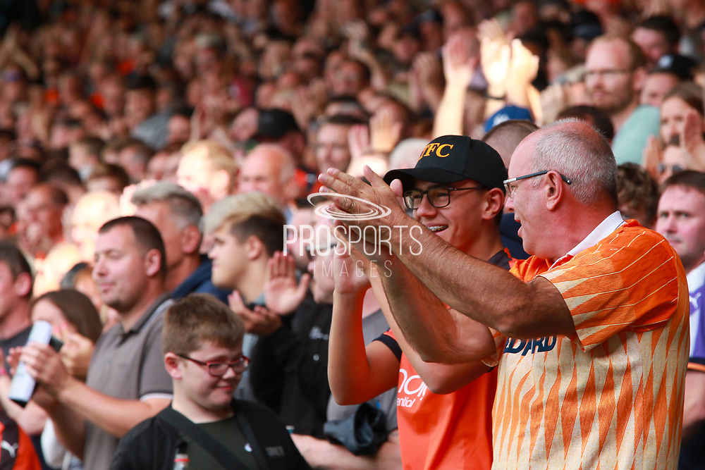 GOAL fans celebrate Luton Town midfielder Andrew Shinnie (11) scoring a goal 1-0 during the EFL Sky Bet League 1 match between Luton Town and Bristol Rovers at Kenilworth Road, Luton, England on 15 September 2018.