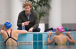 Prince Harry speaks to members of the Australian Invictus swimming squad during a visit to the Aquatic Centre at the Olympic Park Sports Centre in Sydney, Australia, which will be one of the venues for the Invictus Games Sydney 2018.