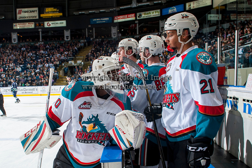 KELOWNA, CANADA - APRIL 26: Michael Herringer #30 stands on the ice and speaks to Devante Stephens #21 of the Kelowna Rockets during a time out against the Seattle Thunderbirds on April 26, 2017 at Prospera Place in Kelowna, British Columbia, Canada.  (Photo by Marissa Baecker/Shoot the Breeze)  *** Local Caption ***