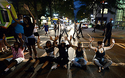 September 21, 2016 - Charlotte, North Carolina, U.S.- Protestors block an intersection at Trade and Tryon Streets. The protestors were rallying against the fatal shooting of Keith Lamont Scott by police on Tuesday evening in the University City area. (Credit Image: © Jeff Siner/TNS via ZUMA Wire)