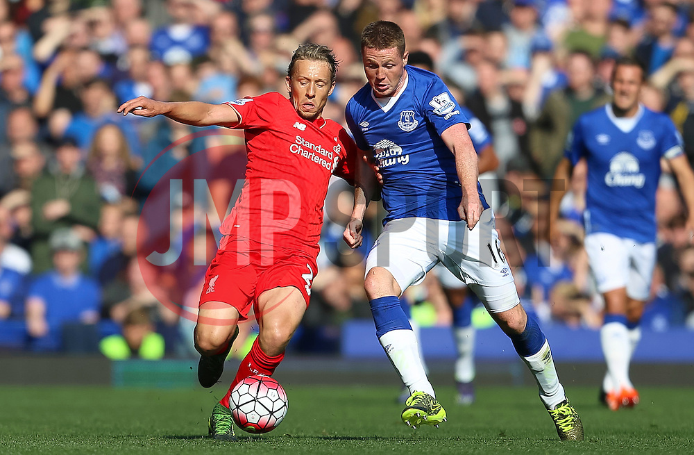 Lucas Leiva of Liverpool and Everton's James McCarthy - Mandatory byline: Matt McNulty/JMP - 07966 386802 - 04/10/2015 - FOOTBALL - Goodison Park - Liverpool, England - Everton  v Liverpool - Barclays Premier League