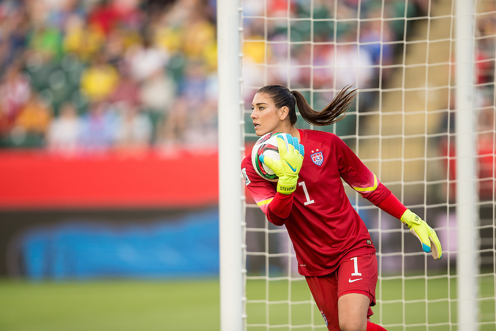American goalkeeper Hope Solo makes a save during the United States' 2-0 win over Colombia in their FIFA Women's World Cup Group of 16 Match at Commonwealth Stadium in Edmonton, Canada on June 22, 2015.   AFP PHOTO/GEOFF ROBINS