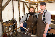 USA, Alaska,Ketchikan,blacksmiths  Jake Beimler and Krystle DeCourcey pose in their open air shop in downtown Ketchikan. MR