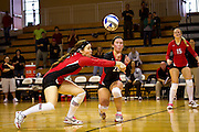 Erin Labasan '11 goes up for a bump next to Kate Duran '12 during the Pioneers' five-set victory over Lake Forest College on Saturday in Darby Gymnasium.