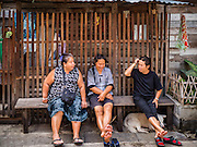 05 JANUARY 2017 - BANGKOK, THAILAND:       Women chat in front of a home in the Pom Mahakan slum community. More than 40 families still live in the Pom Mahakan Fort community. Bangkok officials are trying to move them out of the fort and community leaders are barricading themselves in the fort. The residents of the historic fort are joined almost every day by community activists from around Bangkok who support their efforts to stay. City officials pushed back their deadline and now say that they expect to have the old fort cleared of residents and construction on the new park started by the end of February 2017.      PHOTO BY JACK KURTZ