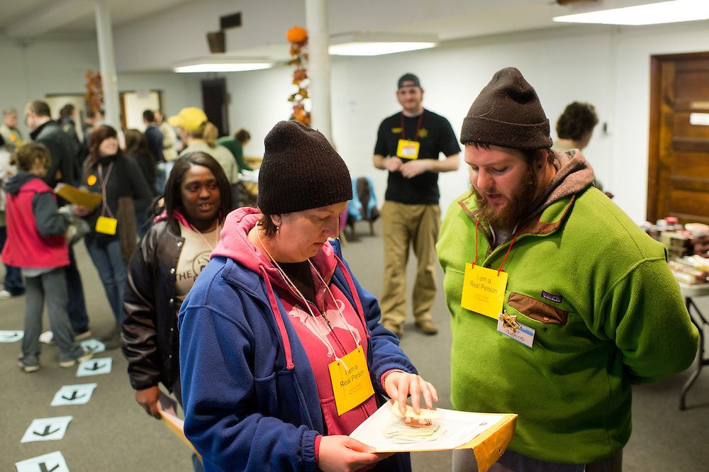 """Athens community member Debbie Rogers, left, and Tim Samson, a student volunteer playing the part of a jailer, interact during the """"Three Days on the Streets: a simulated experience"""" walk at the Good Works Walk Saturday, February 23, 2013. The unique simulation was put on by Good Works workers and student volunteers as a """"non-traditional"""" walking experience. There were four other walking experiences to choose from to fit the needs of all participants."""