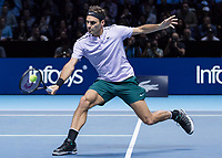 Tennis - 2017 Nitto ATP Finals at The O2 - Day One<br /> <br /> Group Boris Becker Singles: Roger Federer (Switzerland) vs. Jack Sock (USA)<br /> <br /> Roger Federer (Switzerland) with a balletic pose as he returns the ball  at the O2 Arena<br /> <br /> COLORSPORT/DANIEL BEARHAM