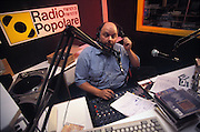 Sergio Ferrentino, journalist, on air with &quot;Sincera amicizia&quot; (sincere friendship) a program of Radio Popolare (Popular Radio) to help sexual encounters among listeners, Milan, august 15, 1995. Radio Popolare is an Italian free and indipendent radio station; its programs are broadcasted on FM and streaming and by satellite. &copy; Carlo Cerchioli<br /> <br /> Sergio Ferrentino, giornalista, in onda con &quot;Sincera amicizia&quot; un programma di Radio Popolare per favoririe gli incontri sessuali tra gli ascoltatori, Milano, 15 agosto 1995. Radio Popolare, &egrave; una radio di informazione libera e indipendente; i suoi programmi sono trasmessi in FM e streaming e via satellite.