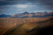 Winter sun shining over the electricity pylons that travel across the mountains that are used to transfer power from the Fierzë Hydroelectric Power Station in Northern Albania on the 12th of December 2018, Albania. The power station dam has a total volume of 8 million cubic meters and has an annual average power output of 1,330GWh. (photo by Andrew Aitchison / In pictures via Getty Images)