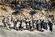 group portrait of mainly female and children farmhands working in the field ca 1930s Japan