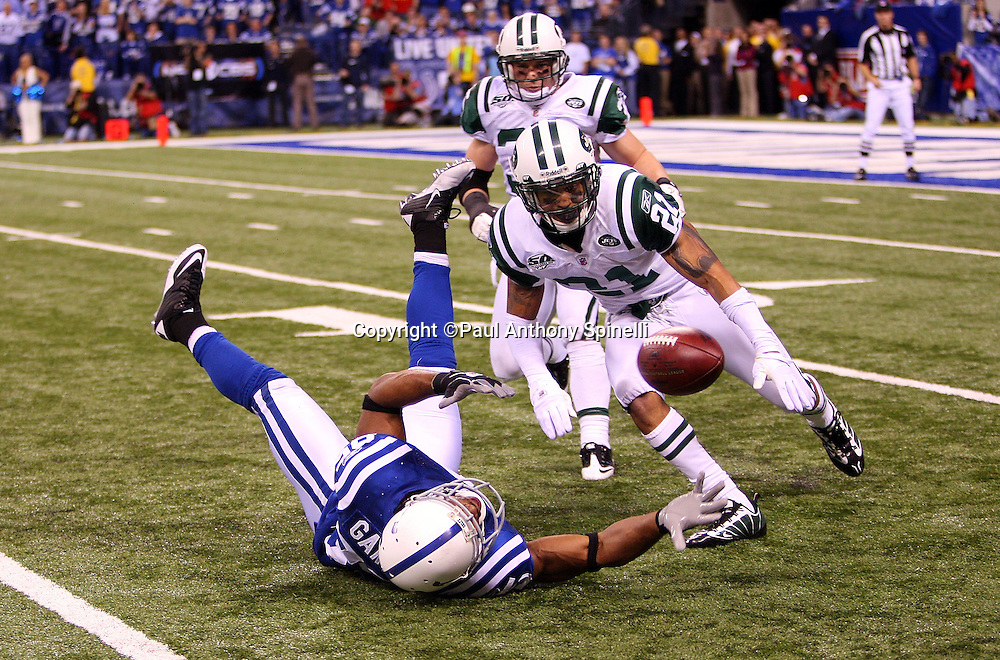 Indianapolis Colts wide receiver Pierre Garcon (85) is unable to catch a fourth quarter pass inside the New York Jets red zone while covered by Jets safety Jim Leonhard (36) and Jets cornerback Dwight Lowery (21) during the AFC Championship football game against the New York Jets, January 24, 2010 in Indianapolis, Indiana. The Colts won the game 30-17. ©Paul Anthony Spinelli