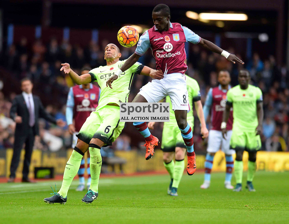 Manchester City Player Fernando tussles with Villa player Idrissa Gana
