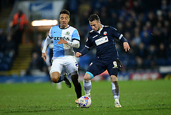 Bolton Wanderers' Adam Le Fondre competes with Blackburn Rovers's Adam Henley - Photo mandatory by-line: Richard Martin-Roberts/JMP - Mobile: 07966 386802 - 11/03/2015 - SPORT - Football - Blackburn - Ewood Park - Blackburn Rovers v Bolton Wanderers - Sky Bet Championship