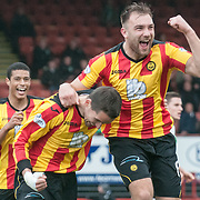 Partick Thistle's Lee Mair and Partick Thistle's Conrad Balatoni celebrate Thistle's 2nd goal. Action from the Partick Thistle v Hibernian game in the Scottish Premiership at Firhill Stadium in Glasgow, 15 March 2014. (c) Paul J Roberts / Sportpix.org.uk
