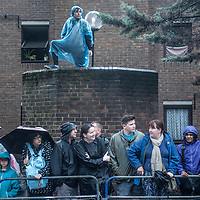 London, UK - 25 August 2014: people watch the parade during the Notting Hill Carnival in London.