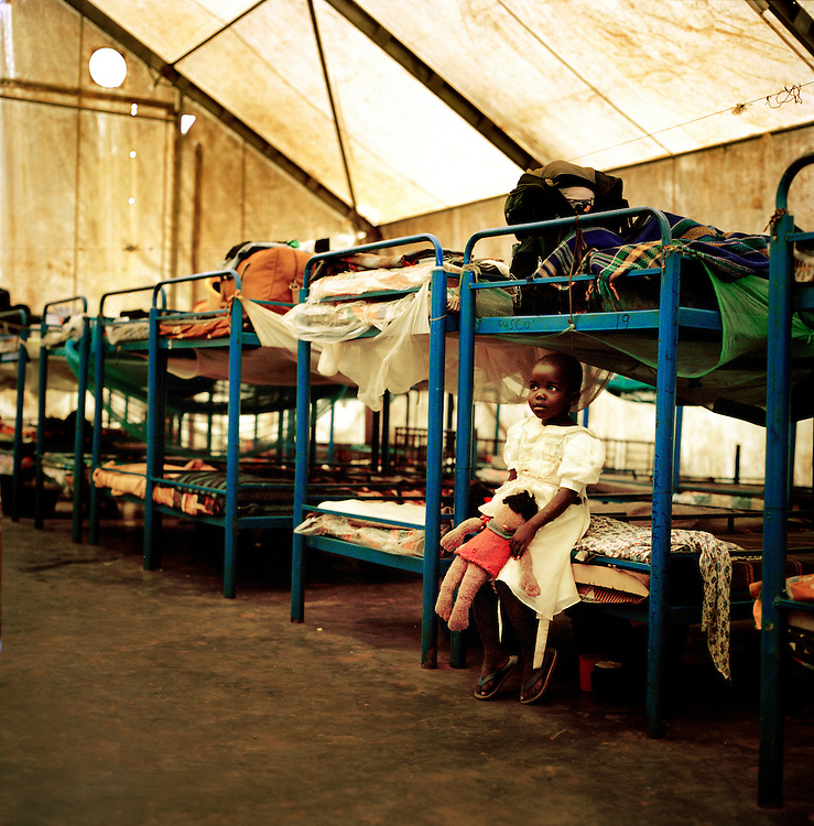 Children in Save the children supported  Gusco rehabilitation centre in Gulu, North Uganda.  The transit camp was originally built to hold maybe 60 children, but with the fighting intensifying in the last 3 years more and more have fled. When I was there more than 250 children were in the centre, where they spend an average 3 weeks, while their families are traced. They have activities every day, film watching, group therapy, sewing for girls and debate clubs. .