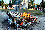 Israel, Jordan Valley, Kibbutz Ashdot Yaacov, Lag Ba'Omer celebration with a bonfire. Potatoes wrapped in foil cooking in the fire