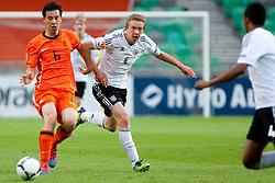 Thom Haye of Netherlands and Nico Brandenburger of Germany during the UEFA European Under-17 Championship Final match between Germany and Netherlands on May 16, 2012 in SRC Stozice, Ljubljana, Slovenia. (Photo by Urban Urbanc / Sportida.com)