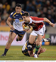 18 June 2013; Conor Murray, British & Irish Lions, escapes the tackle of Leon Power, Brumbies. British & Irish Lions Tour 2013, Brumbies v British & Irish Lions. Canberra Stadium, Bruce, Canberra, Australia. Picture credit: Stephen McCarthy / SPORTSFILE