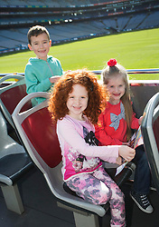 Repro Free: 03/03/2014 Kyle Burkem, (6) from Donaghmede and Alisha Burke (6) from Artane and Ella Crolly (7) from Malahide find themselves in the middle of Croke Park as they help launch of the new City Sightseeing bus route at Croke Park stadium which now encompasses the Botanic Gardens, Glasnevin Cemetery and Croke Park.<br /> <br /> The new route will be open to the public from March 10th 2014 and extends the existing tour route. This &lsquo;true blue&rsquo; route will take visitors on a journey that gives an insight into the struggles and victories that shaped this country encapsulating social, cultural and sporting history, amazing views and landscapes from three of Dublin&rsquo;s top 10 attractions (Tripadvisor). In this decade of commemorations, these sites are at the forefront in remembering and commemorating great events and people in Irish history. Picture Andres Poveda