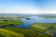 Nederland, Noord-Holland, Gemeente Castricum, 13-06-2017; De Woude, dorp aan het Alkmaardermeer.<br /> Village at lake Alkmaar.<br /> <br /> luchtfoto (toeslag op standard tarieven);<br /> aerial photo (additional fee required);<br /> copyright foto/photo Siebe Swart