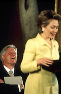 President Bill Clinton laughs at a line in First Lady Hillary Rodham Clinton's speech on May 2, 2002..Photograph by Dennis Brack BBBs 20