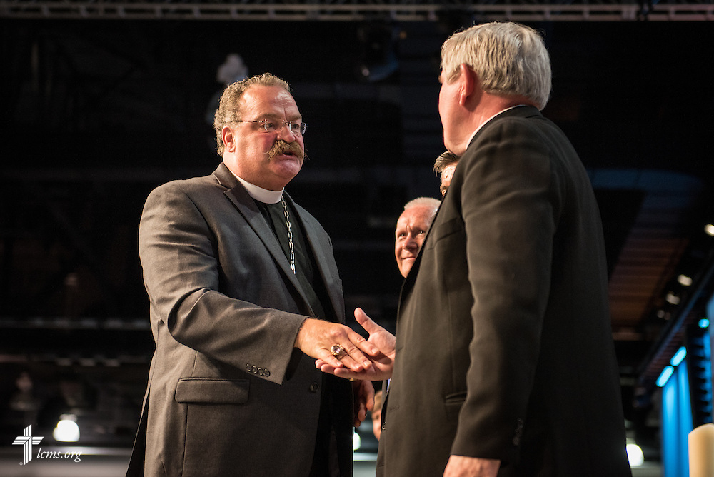 LCMS President Harrison greets Archbishop Jerome Listecki of the Milwaukee Archdiocese on Tuesday, July 12, 2016, at the 66th Regular Convention of The Lutheran Church–Missouri Synod, in Milwaukee. LCMS/Frank Kohn