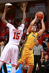 05 November 2016:   Joseph Tagarelli shoots a fader to stay away from Andre Washington(15) during an NCAA  mens basketball game where the Quincy Hawks lost to the Illinois State Redbirds in an exhibition game at Redbird Arena, Normal IL
