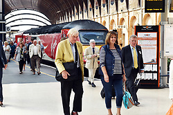 Passengers alighting from Virgin train, York Railway Station platform UK