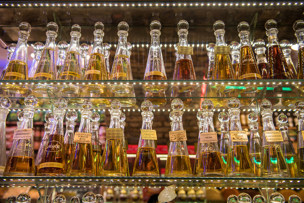 Shelves containing glass bottles of perfume all in a row at Istanbul Spice bazaar in Turkey.