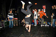 A break dance dancer standing on his right hand. UK B-Boy championships 06. 08/10/2006