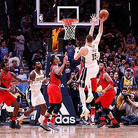 09 April 2018: Denver Nuggets center Nikola Jokic (15) goes for the jump shot over Portland Trail Blazers center Zach Collins (33) during the Denver Nuggets 88-82 victory over the Portland Trail Blazers, at the Pepsi Center, Denver, Colorado, USA.