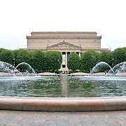 US National Archives seen across the fountain in the Smithsonian Sculpture Garden, Washington DC