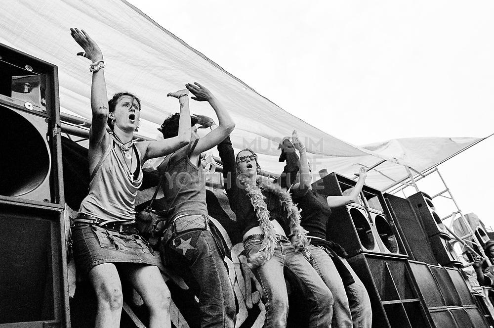 A group of girls dancing on a rig at Czechtek, Czech Republic, 2004.