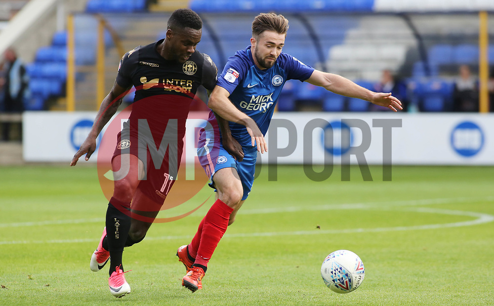 Gwion Edwards of Peterborough United battles with Gavin Massey of Wigan Athletic - Mandatory by-line: Joe Dent/JMP - 23/09/2017 - FOOTBALL - ABAX Stadium - Peterborough, England - Peterborough United v Wigan Athletic - Sky Bet League One