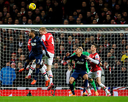 Man Utd Defender Patrice Evra (FRA) and Arsenal Defender Per Mertesacker (GER) compete in the air in front of the Arsenal goal - Photo mandatory by-line: Rogan Thomson/JMP - 07966 386802 - 12/02/14 - SPORT - FOOTBALL - Emirates Stadium, London - Arsenal v Manchester United - Barclays Premier League.