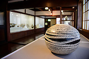 "Photo shows a vase on display inside the Museum Of Ceramic Art tinside the Toyoma Folk Village in Toyama City Japan. More than 100 ceramic works are on display inside the museum, which is built in the architectural style known as ""azuma-dachi."""