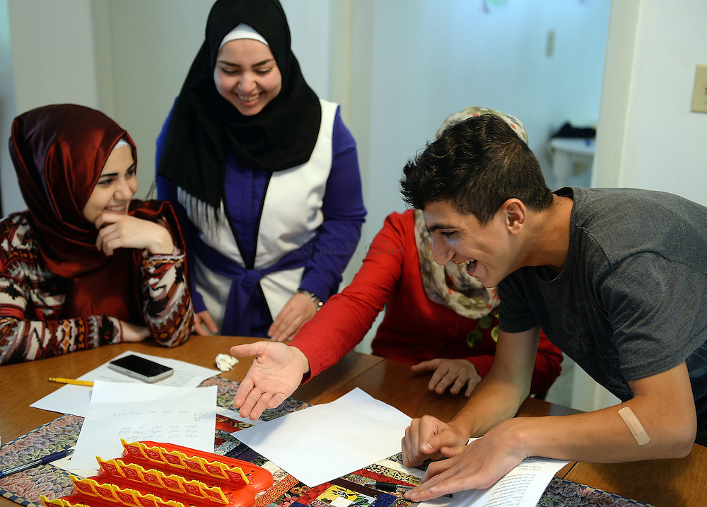 6/30/16 :: REGION :: LYNCH :: Hassan Mahmud and Fahima Jmoo and their children Hanif, Fidan and Fulla work with volunteers from Ledyard Congregational Church on English language lessons Thursday, June 30, 2016 in their rented Ledyard home. The family are refugees from the conflict in Syria and lived for three years in Turkey before finally receiving approval to come to the United States. The volunteers are: Rich and Bonnie Denton and their son Henry, 11 and Sarah Holdridge. Translators Zin Arnaout and Yomen Arnaout joined later. (Sean D. Elliot/The Day)