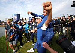Team Europe's Tommy Fleetwood (top) and Ian Poulter celebrates after Europe win the Ryder Cup during the Singles match on day three of the Ryder Cup at Le Golf National, Saint-Quentin-en-Yvelines, Paris.