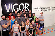 Group photo at Vigor Crossfit in Moraine, Wednesday, January 25, 2012. front row: Sarah Belt of Kettering; Second row: Kirsten Raynor of Centerville, Anya Penner of Dayton, Gabi Sawyer of Beavercreek, Alora Penner of Dayton, Danielle McCown and Kerry Penner  Third row: Chad Banter of Centerville, Kristen Pertner of Dayton, Nicole Hughes of Dayton, Jason Hoskins of Dayton, Anne Keeton of Kettering, Tracy Belt of Kettering and Abby Griest of West Carrollton.Back row: Aaron Pertner of Dayton, Andrea McDermott of Moraine, Sarah Collinsworth of Dayton, Alyssa Medeiros of Beavercreek and Sarah Stewart of Kettering