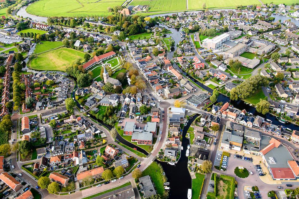 Nederland, Friesland, Gemeente Heerenveen, 10-10-2014; Akkrum met kerk Terptsjerke en monument Welgelegen (met rood pannendak).<br /> Frisian village.<br /> luchtfoto (toeslag op standard tarieven);<br /> aerial photo (additional fee required);<br /> copyright foto/photo Siebe Swart
