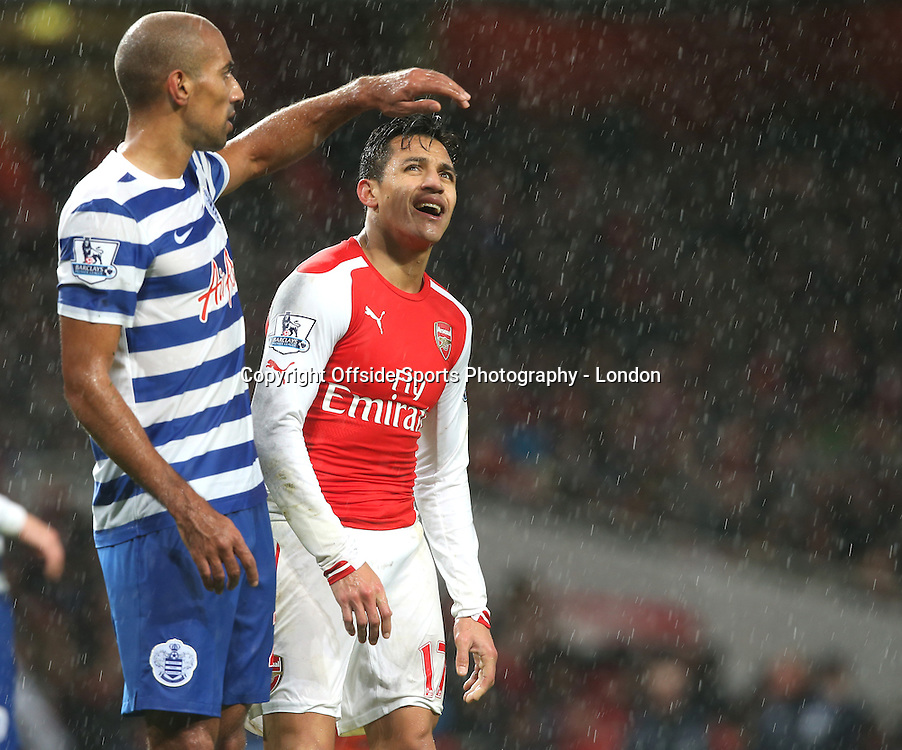 26 December 2014 Premier League Football - Arsenal v Queens Park Rangers ; Alexis Sanchez of Arsenal stands in the rain.<br />  Photo: Mark Leech.