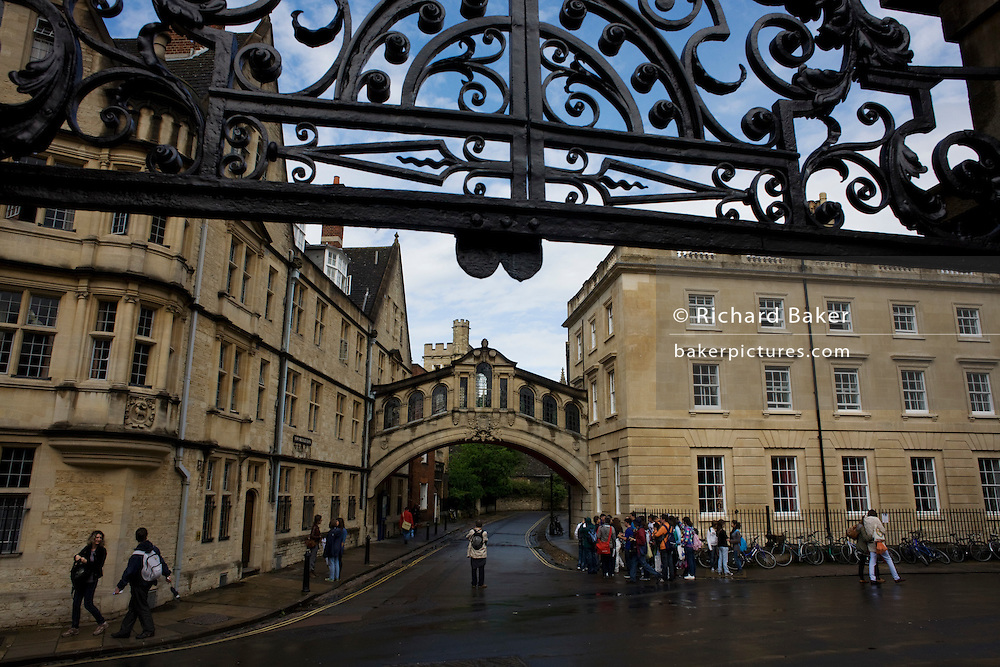 Oxford's Bridge of Sighs looking from the Bodleian arch along New College Lane with junction of Catte St. ..Hertford Bridge, popularly known as the Bridge of Sighs, is a skyway over New College Lane in Oxford, England. The bridge is often referred to as the Bridge of Sighs because of its supposed similarity to the famous Bridge of Sighs in Venice. However, Hertford Bridge was never intended to be a replica of the Venetian bridge, and indeed it bears a closer resemblance to the Rialto Bridge in the same city.