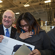WASHINGTON,DC - MAR18: Lashae Hunter, a senior at Cesar Chavez Public Charter School for Public Policy, was surprised at school with a hand-delivered acceptance letter and full scholarship from George Washington University President Steven Knapp and Dean of Admissions, Karen Felton, March 18, 2015, through the Stephen Joel Trachtenberg Scholarship program. (Photo by Evelyn Hockstein/For The Washington Post)