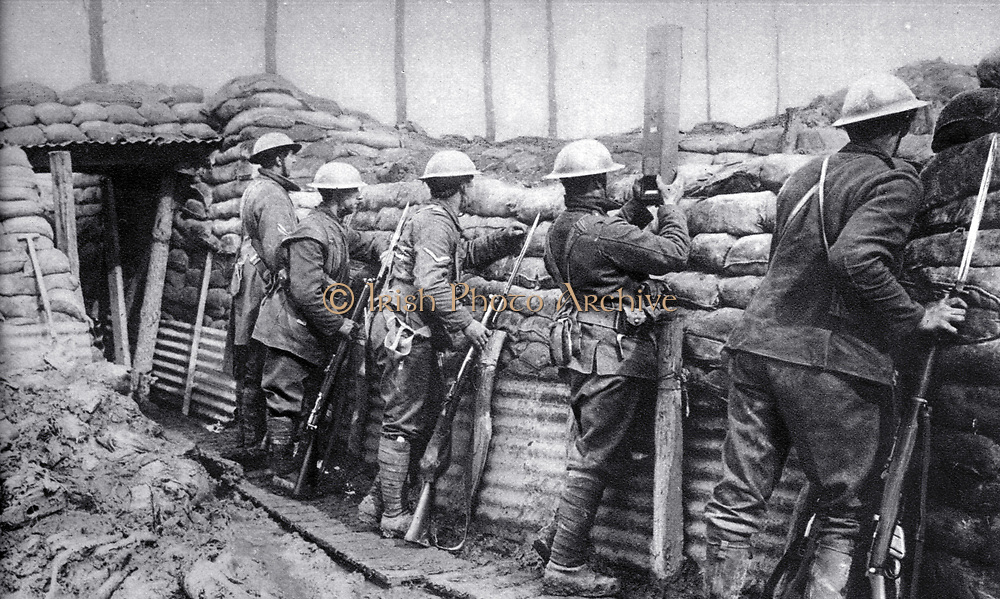 Canadian infantry in the trenches ready to repel an attack.