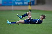 14th September 2019; Dens Park, Dundee, Scotland; Scottish Championship, Dundee Football Club versus Alloa Athletic; Josh McPake of Dundee in agony after picking up an injury