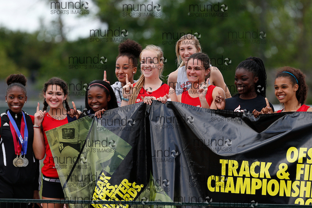 BCSS celebrates their win at the 2013 OFSAA Track and Field Championship in Oshawa Ontario, Sunday,  June 9, 2013.<br /> Mundo Sport Images/ Geoff Robins