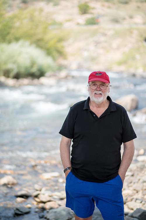 2017 SEP 06: Miles Williams, a member of the West Denver Chapter of Trout Unlimited, survey the work they've helped to facilitate on the Clear Creek in Jefferson County, Colorado.