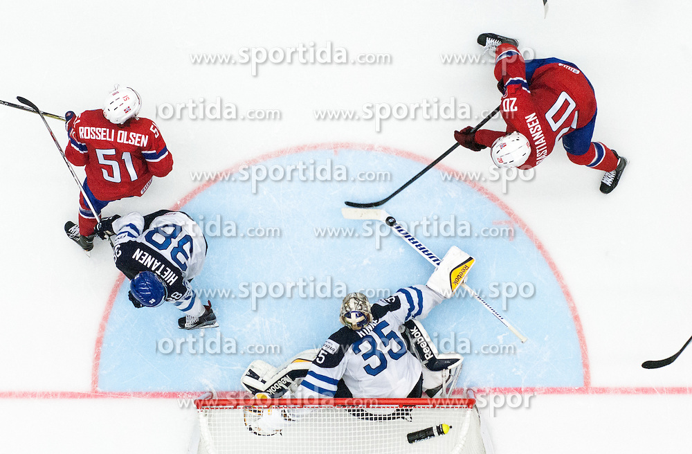 Anders Bastiansen of Norway and Mats Rosseli Olsen of Norway vs Pekka Rinne of Finland during Ice Hockey match between Norway and Finland at Day 4 in Group B of 2015 IIHF World Championship, on May 4, 2015 in CEZ Arena, Ostrava, Czech Republic. Photo by Vid Ponikvar / Sportida